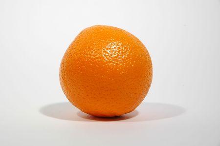 One orange on white. photo