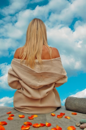 back rub: Girl relaxing after day in spa center and looking in beautyfull sky with clouds. Stock Photo
