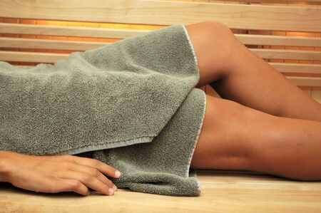 Woman in sauna relaxing. Stock Photo