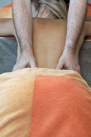 Girl relaxing and one man executing relax massage. photo
