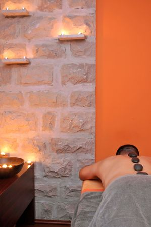 Exotic massage room in wellness center. Stock Photo