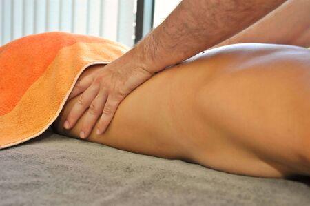 Massage treatment in spa center.