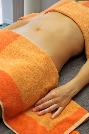 Girl lying and relaxing after massage treatment.