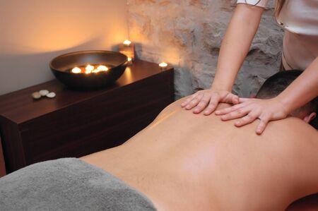 Exotic oil massage treatment. Stock Photo