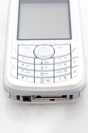 wireles: Mobile phone. View on keyboard and screen.