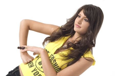 Young brunette happy girl in yelow sport t shirt with beautyful face and eyes.