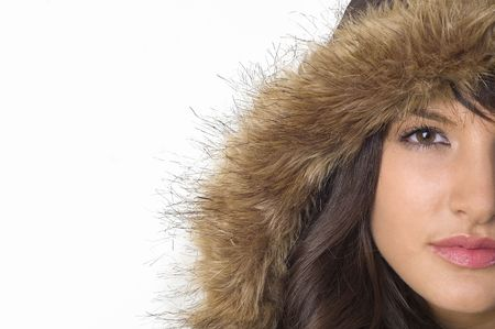 Young brunette girl in brown winter jacket.Happy face and worm look.