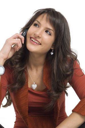 Young brunette girl with mobile phone on white background.