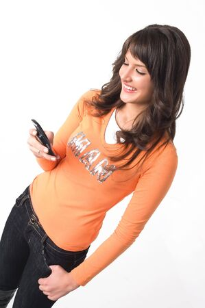 Young brunette girl with mobile phone in hand.
