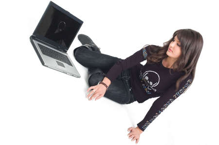 lap top: Young brunette girl in black with lap top computer representing modern communications.