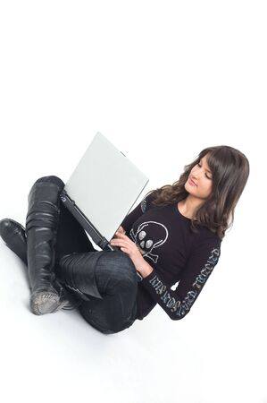 Young brunette girl in black with lap top computer representing modern communications. photo