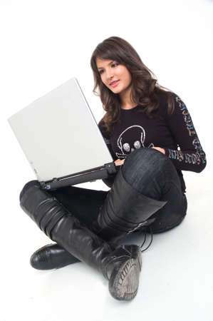 Young brunette girl in black with lap top computer representing modern communications.