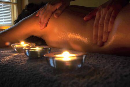 Girl relaxing. Massage salon with accessories. Anti stress massage.