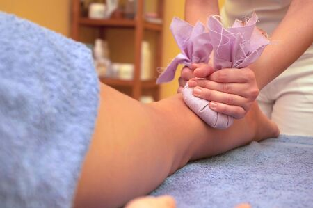 Girl relaxing. Massage salon with accessories. Anti stress massage.
