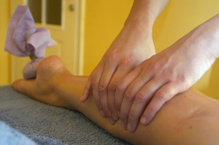 rela: Girl relaxing. Massage salon with accessories. Anti stress massage.