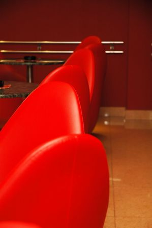 Interior of modern restaurant. Red leather and luxury chairs. Stock Photo