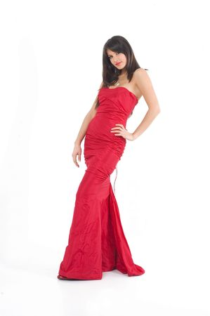 Young brunette girl in fashionable sexy red dress. Stock Photo