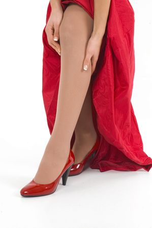 Shiny red sexy high hill shoes.Girl in red with red shoes. Stock Photo - 2474953