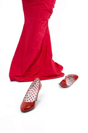 Shiny red sexy high hill shoes.Girl in red with red shoes. Stock Photo - 2474939