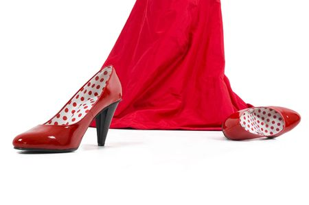 Shiny red sexy high hill shoes.Girl in red with red shoes. Stock Photo