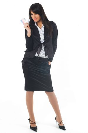 Business woman in black casual dress. Young brunette with credit cards in hand.