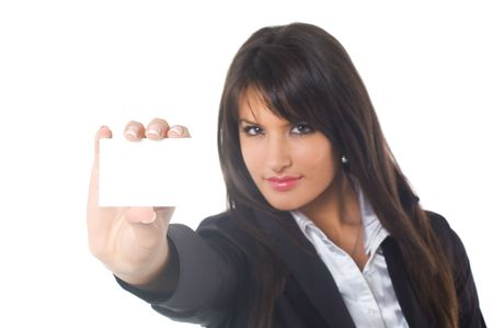Business woman in black casual dress. Young brunette with blank business card in hand.