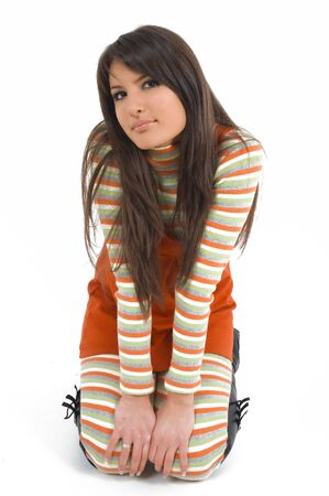 Young brunette girl in orange dress. Stock Photo - 2852252