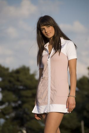 Young brunette girl in sport wear posing on the sun after training. Stock Photo - 3418949