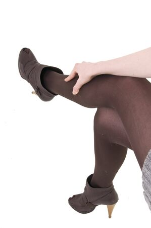 Young girl legs in stockings with high heel shoes.