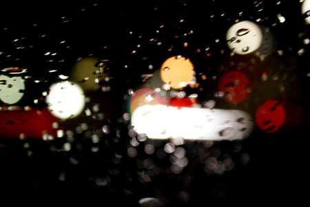 Bokeh rain night day with raindrops