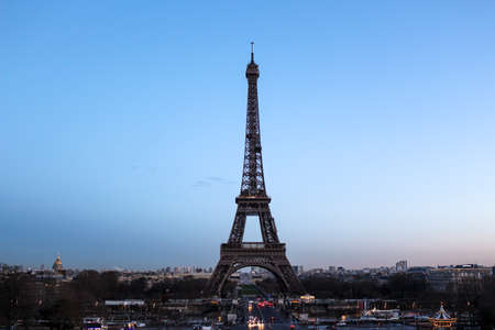 Eiffel Tower on Champs de Mars in Paris, France at the evening Editorial