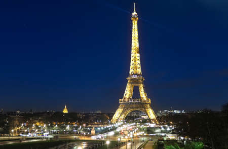 Eiffel Tower on Champs de Mars in Paris, France at the evening 에디토리얼