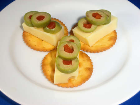 Hors Douerves: Crackers and Swiss Cheese with Olives