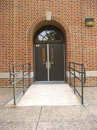 wheelchair access: School doorway with wheelchair access ramp. Stock Photo