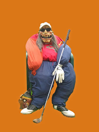 Scary golfer scarecrow on an orange background. Imagens