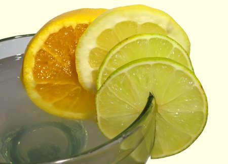 margarita glass: Rim of margarita glass, garnished with orange, lemon and mile slices.