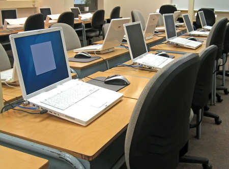School computer lab with desks and chairs.