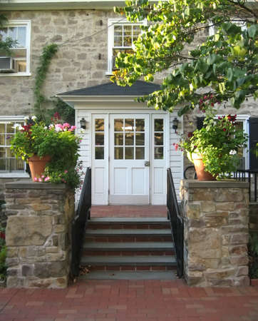 Front Entrance with Steps and Porch on Old Stone House