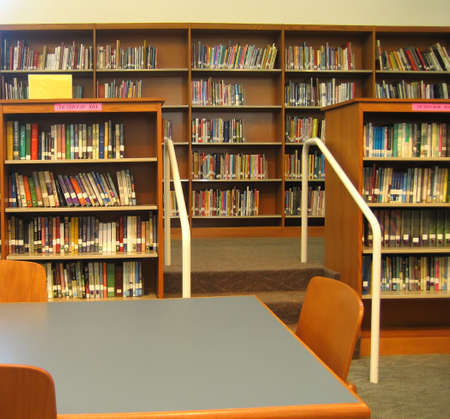School Library with Shelves, Desks and Chairs Stock Photo