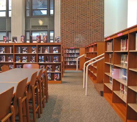 School Library with Bookshelves, Tables, Chairs and High Ceiling.