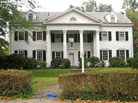 Stately White Three Story Home in the Autumn