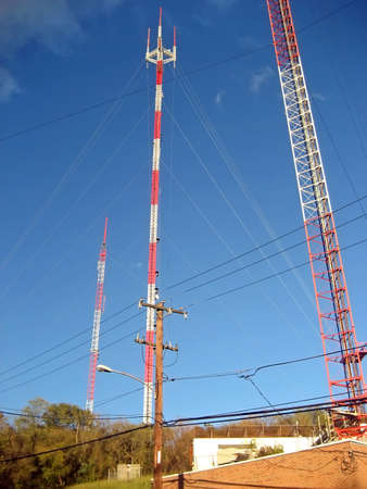 Three Tall ReceptionTransmitter Towers Against A Blue Sky