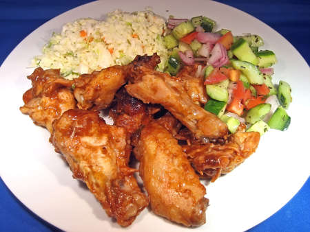 Barbecue Chicken Wings, Coleslaw, and Tomato Cucumber Salad