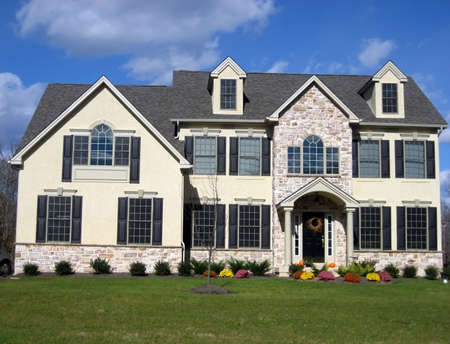 roomy: Executive style house with lawn and mums. Stock Photo