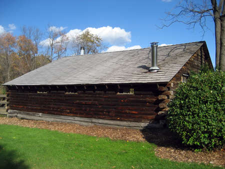 Well-preserved Log Cabin in A Park On A Crisp Autumn Day photo