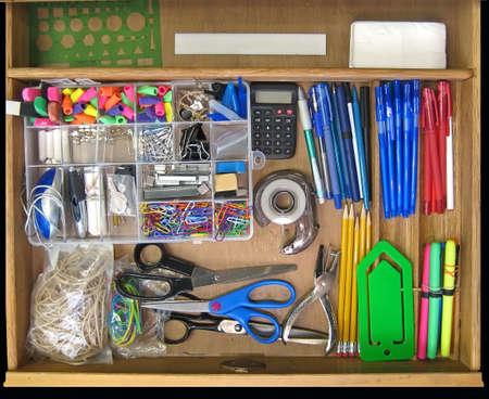 Open teacher's desk drawer full of supplies. 스톡 콘텐츠