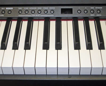 Close-Up of Electronic Piano Keyboard and Controls