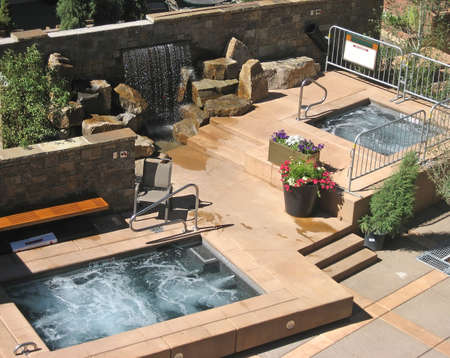 bathtubs: Luxurious hotel patio with hot tubs. Stock Photo
