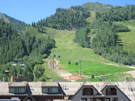Mountain resort with rooftops and gondola.