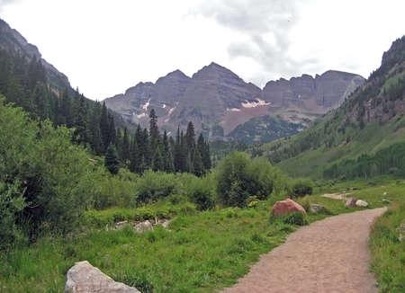 Path through a scenic Rocky Mountain park.
